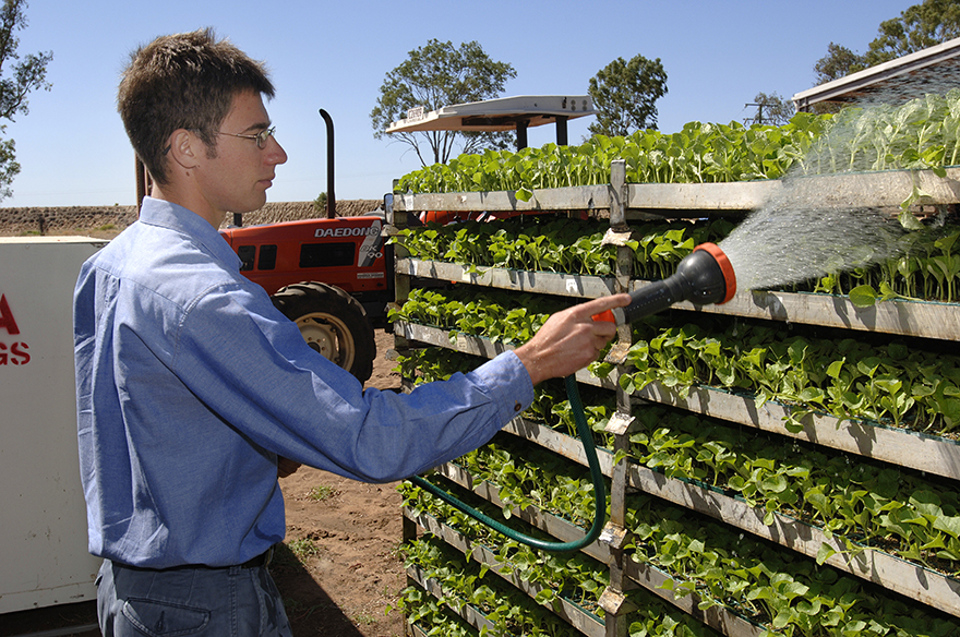 image of farmer watering plants