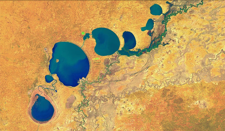 A false colour satellite image of Menindee Lakes, showing inflows filling the lakes for the first time in 5 years