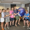 Group of teenage students with a blown-up globe.