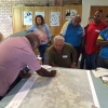 Indigenous community members looking at a map